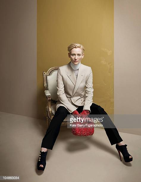Actress Tilda Swinton poses at a portrait session for Madame Figaro Magazine in 2010 Outfit and accessories by Givenchy heels by Christian Louboutin...