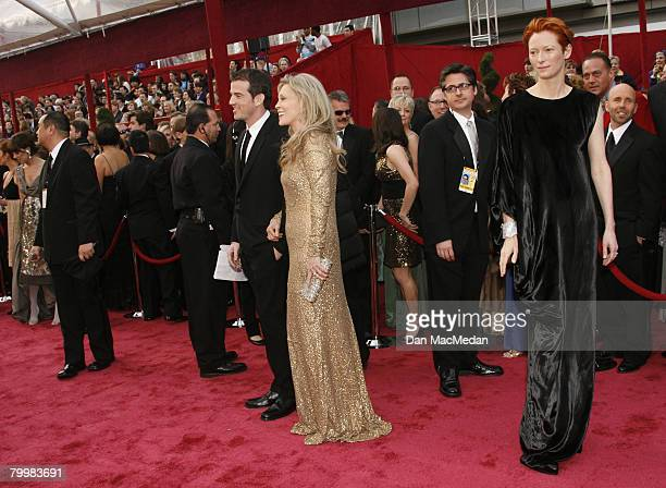Actress Tilda Swinton poses on the red carpeet beside actress Faye Dunaway and her son Liam O'Neill as they arrvie to attend The 80th Annual Academy...