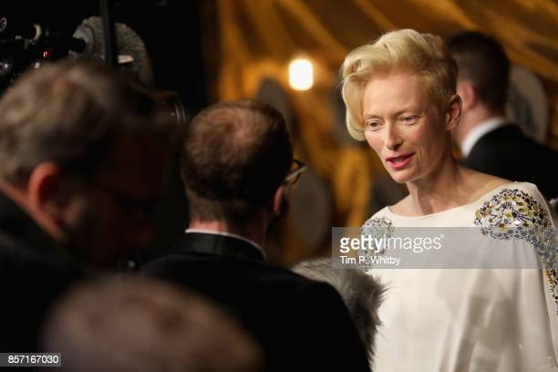 Actress Tilda Swinton talks to a reporter as she attends the BFI Luminous Fundraising Gala at The Guildhall on October 3 2017 in London England
