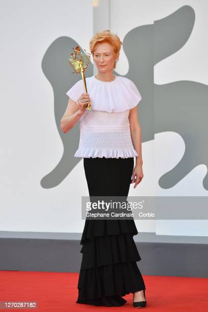 """Actress Tilda Swinton walks the red carpet ahead of the Opening Ceremony and the """"Lacci"""" red carpet during the 77th Venice Film Festival at on..."""