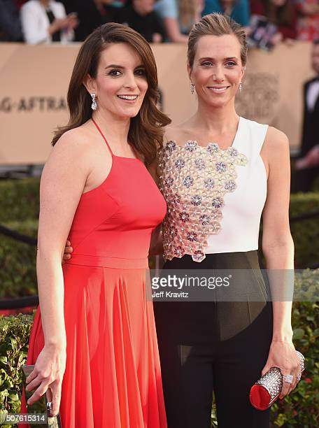 Actress Tina Fey and actress Kristen Wiig attend the 22nd Annual Screen Actors Guild Awards at The Shrine Auditorium on January 30 2016 in Los...