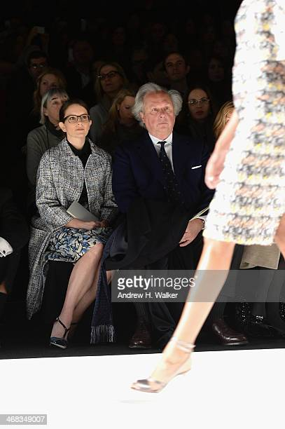 Actress Tina Fey and Graydon Carter attend the Carolina Herrera fashion show during Mercedes-Benz Fashion Week Fall 2014 at Lincoln Center for the...