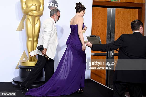 Actress Tina Fey and production designer Colin Gibson winner of Best Production Design for 'Mad Max' exit the press room during the 88th Annual...