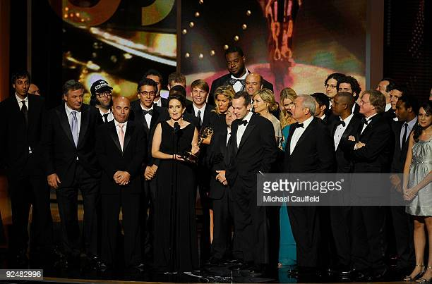 Actress Tina Fey and the cast and crew of '30 Rock' accept their award onstage at the 61st Primetime Emmy Awards held at the Nokia Theatre on...