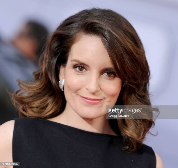 """Actress Tina Fey arrives at the Los Angeles premiere of """"Muppets Most Wanted"""" at the El Capitan Theatre on March 11, 2014 in Hollywood, California."""