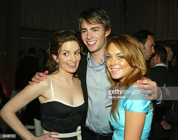 Actress Tina Fey poses with fellow cast members Jonathan Bennett and Lindsay Lohan at the afterparty for Paramount's Mean Girls at the Cinerama Dome...