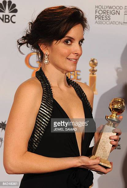 Actress Tina Fey poses with her award for Best Performance by an Actress in a Television SeriesMusical or Comedy for ' 30 Rock' in the press room at...