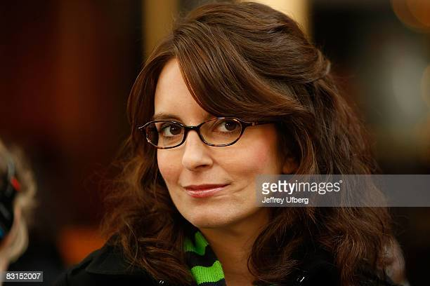 """Actress Tina Fey stands on location during filming for """"30 Rock"""" at Rockefeller Center on October 6, 2008 in New York City."""