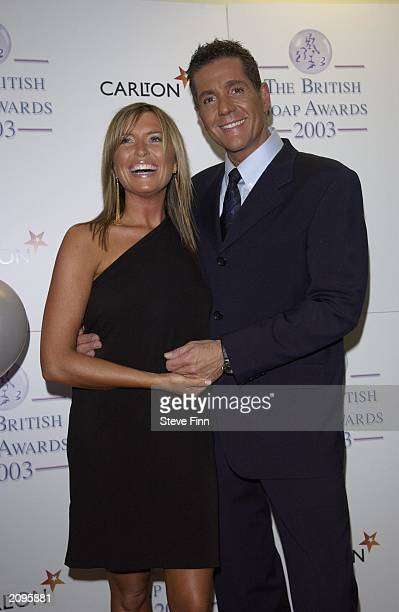 Actress Tina Hobley with TV presenter Dale Winton in the pressroom at the 5th Annual British Soap Awards in London on May 10th 2003