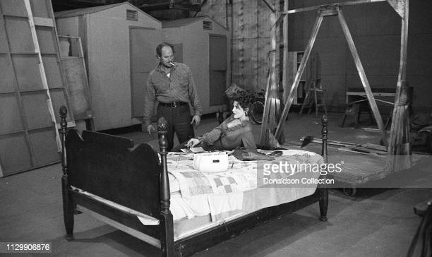 Actress Tina Louise rehearses with a man on a bed in 1953