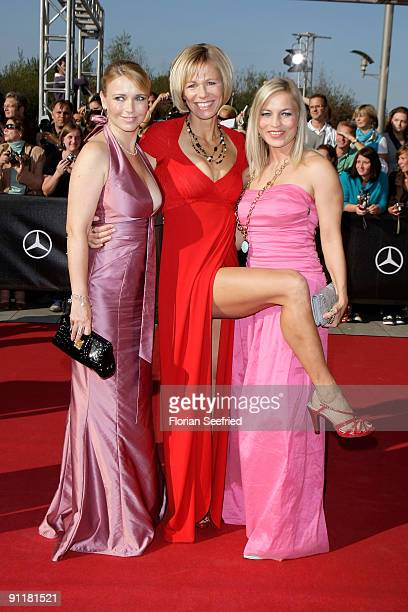 Actress Tina Ruland and actress Claudine Wilde and Regina Halmich arrive for the German TV Award 2009 at the Coloneum on September 26 2009 in Cologne...