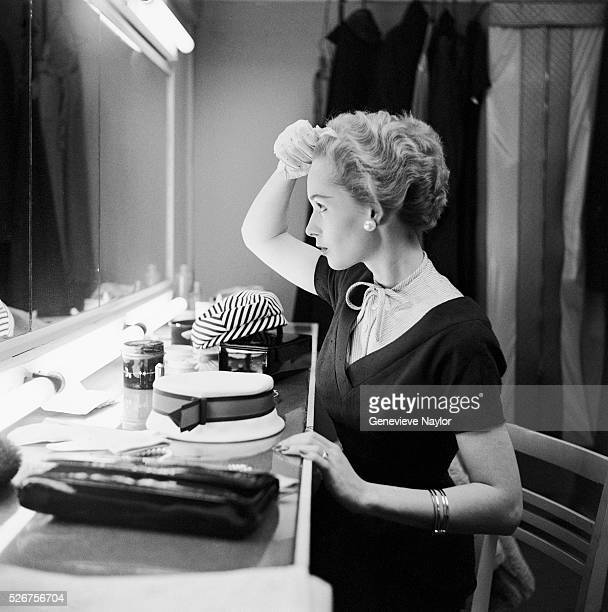Actress Tippi Hedran applies makeup in preparation for a photo shoot in Genevieve Naylor's New York photo studio