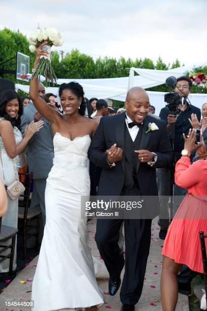 Actress Tish Graves and songwriter Eric Dawkins on their wedding day on October 21 2012 in Woodland Hills California