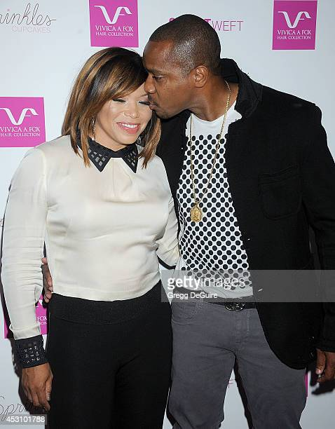 Actress Tisha Campbell and Duane Martin arrive at the Vivica A. Fox 50th Birthday party at Philippe Chow on August 2, 2014 in Beverly Hills,...
