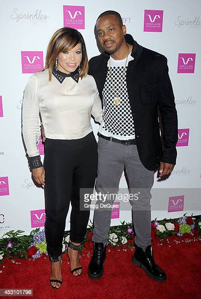 Actress Tisha Campbell and Duane Martin arrive at the Vivica A Fox 50th Birthday party at Philippe Chow on August 2 2014 in Beverly Hills California