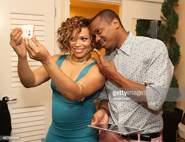 Actress Tisha CampbellMartin of ABC's 'Dr Ken' and actor Duane Martin attend the Getty Images Portrait Studio powered by Samsung Galaxy at 2015...