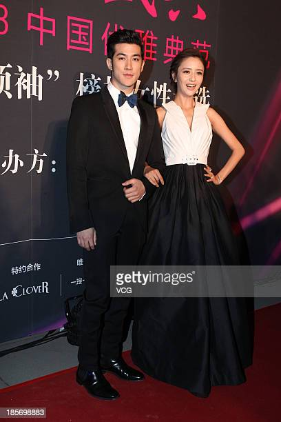 Actress Tong Liya and actor Aarif Lee attend 2013 China Elegance Grand Ceremony at National Aquatic Center on October 23 2013 in Beijing China