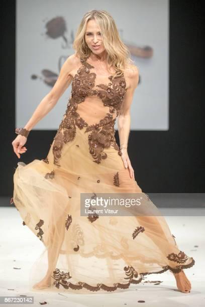 Actress Tonya Kinzinger walks the Runway during 'Le Defile des Robes en Chocolats' during the 'Salon du Chocolat Paris 2017' at Parc des Expositions...