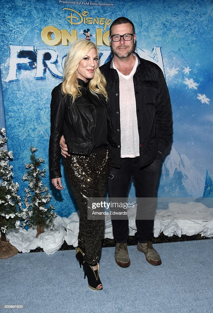 Actress Tori Spelling (L) and actor Dean McDermott arrive at the premiere of Disney On Ice's 'Frozen' at Staples Center on December 10, 2015 in Los Angeles, California.