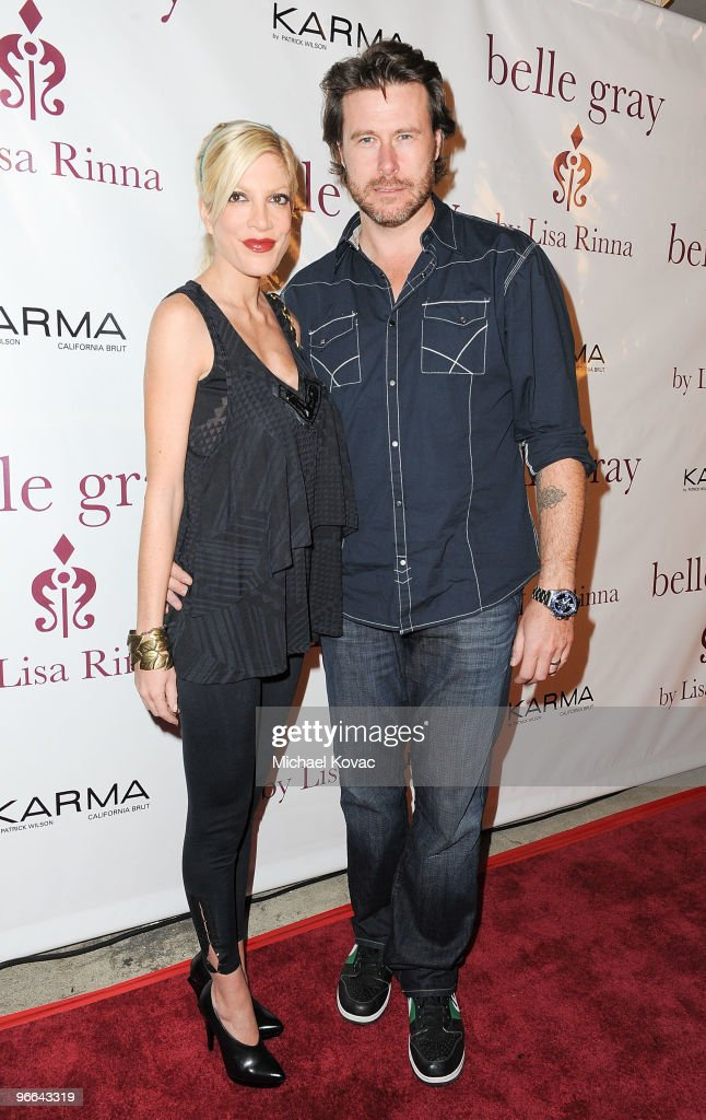 Actress Tori Spelling and actor Dean McDermott arrives at Harry Hamlin and Lisa Rinna Celebration of the 7th Anniversary of Belle Gray Boutique at Belle Gray Boutique on February 12, 2010 in Los Angeles, California.