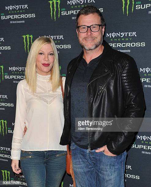 Actress Tori Spelling and actor Dean McDermott attend Monster Energy Supercross at Angel Stadium of Anaheim on January 23 2016 in Anaheim California