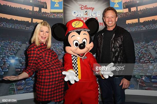Actress Tori Spelling and Actor Ian Ziering attend Disney On Ice Presents Worlds Of Enchantment Celebrity Guests at Staples Center on December 17...