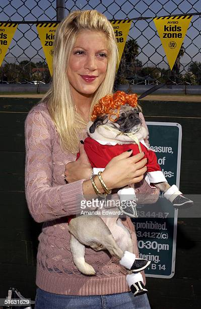 Actress Tori Spelling and her dog Mimi LaRue attend the 3rd Annual BowWowWeen on October 31 2004 at the Barrington Dog Park in Los Angeles California