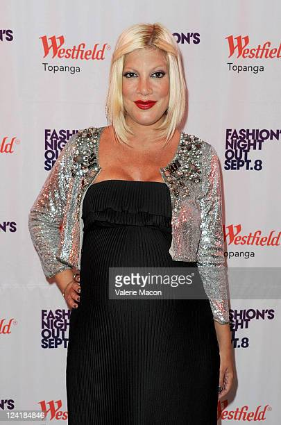 Actress Tori Spelling arrives at Fashion's Night Out at Westfield Topanga on September 8 2011 in Topanga California