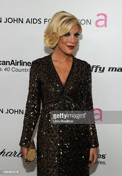 Actress Tori Spelling arrives at the 19th Annual Elton John AIDS Foundation Academy Awards Viewing Party at the Pacific Design Center on February 27...