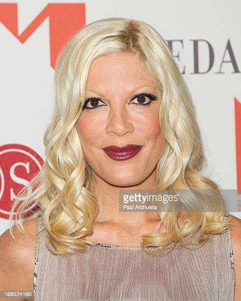 Actress Tori Spelling attends the Helping Hand of Los Angeles' 84th annual Mother's Day luncheon at the Beverly Hills Hotel on May 10 2013 in Beverly...