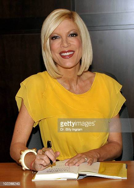 """Actress Tori Spelling signs copies of her new book """"Uncharted TerriTORI"""" at Barnes & Noble bookstore at The Grove on June 21, 2010 in Los Angeles,..."""