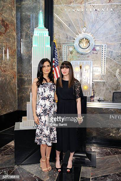 Actress Torrey DeVitto and Women's Health magazine ediotorinchief Amy Laird attend the lighting of The Empire State Building green on behalf of The...