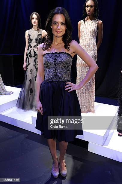 Actress Torrey DeVitto poses on the runway at the Lorena Sarbu Fall 2012 Presentation during MercedesBenz Fashion Week at The Box at Lincoln Center...