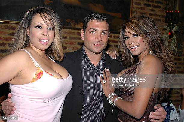 Actress Traci Bingham with her sister Jenna and Antonio Misuraca at The Forge Restaurant to celebrate Art Basel week by auctioning off her swimsuit...