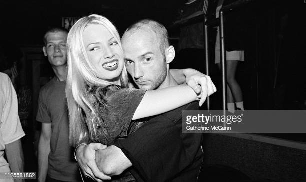 Actress Traci Lords and Musician Moby pose for a portrait at Club USA in 1995 in New York City New York