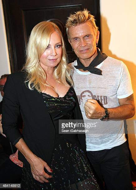 Actress Tracy Lords and musician Billy Idol pose back stage at the Johnny Ramone 10th Anniversary Celebration at Hollywood Forever on August 24 2014...