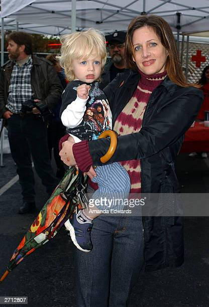 Actress Tracy Nelson poses with her son Elijah backstage at the Love Ride 20 at HarleyDavidson/Buell of Glendale November 9 2003 in Glendale...