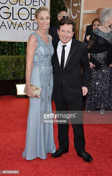 Actress Tracy Pollan and actor Michael J Fox attend the 71st Annual Golden Globe Awards held at The Beverly Hilton Hotel on January 12 2014 in...