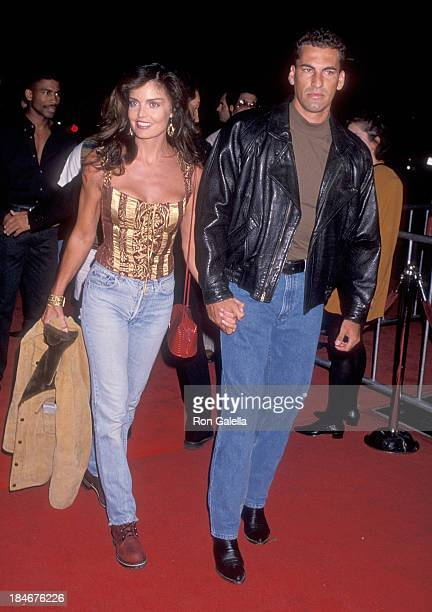 Actress Tracy Scoggins and date attend The River Wild Hollywood Premiere on September 25 1994 at the Mann's Chinese Theatre in Hollywood California