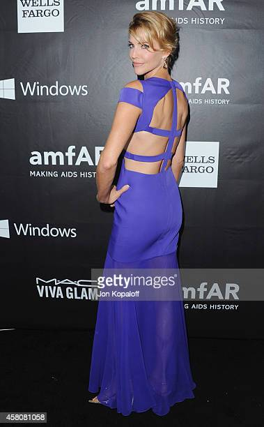 Actress Tricia Helfer arrives at the 2014 amfAR LA Inspiration Gala at Milk Studios on October 29 2014 in Hollywood California