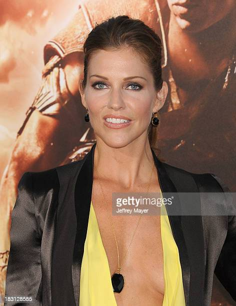 Actress Tricia Helfer arrives at the Los Angeles premiere of 'Riddick' at the Westwood Village Theatre on August 28 2013 in Westwood California
