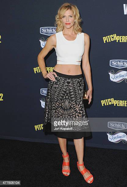 Actress Tricia Helfer arrives at the Los Angeles Premiere Pitch Perfect 2 at Nokia Theatre LA Live on May 8 2015 in Los Angeles California