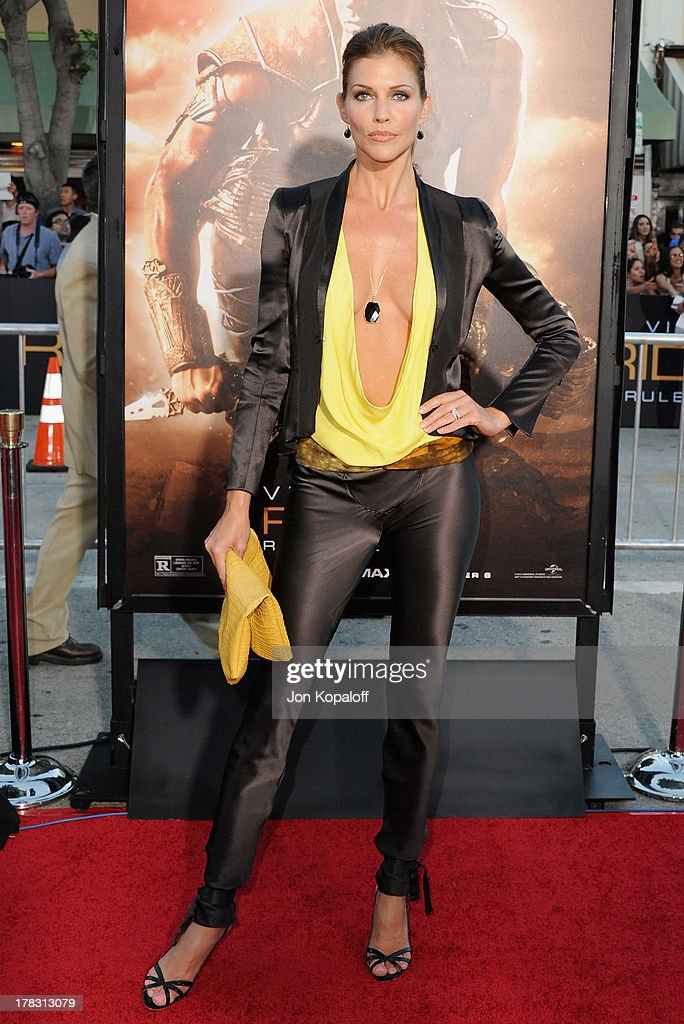 Actress Tricia Helfer arrives at the Los Angeles Premiere 'Riddick' at the Mann Village Theater on August 28, 2013 in Westwood, California.