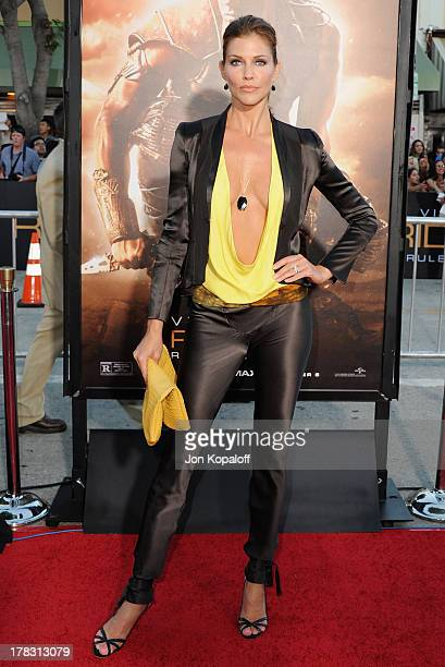 Actress Tricia Helfer arrives at the Los Angeles Premiere 'Riddick' at the Mann Village Theater on August 28 2013 in Westwood California