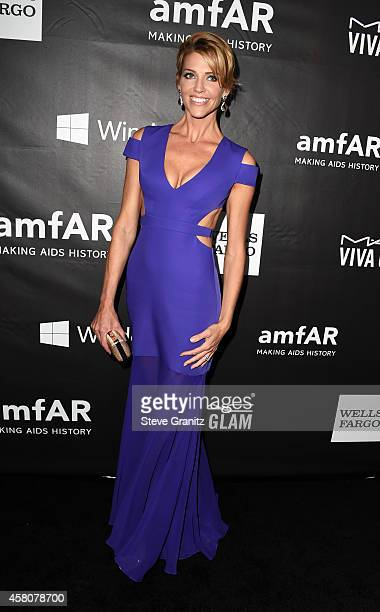 Actress Tricia Helfer attends amfAR LA Inspiration Gala honoring Tom Ford at Milk Studios on October 29 2014 in Hollywood California