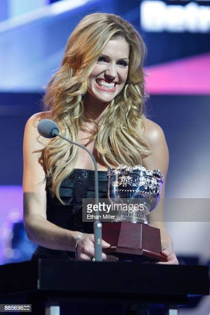 Actress Tricia Helfer presents the Frank Selke Trophy during the 2009 NHL Awards at the Palms Casino Resort on June 18 2009 in Las Vegas Nevada