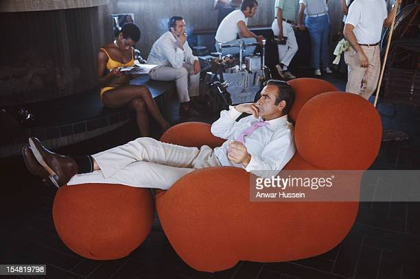 Actress Trina Parks and Scottish actor Sean Connery relax between takes on the set of the James Bond film 'Diamonds Are Forever', USA, 1971. They are...