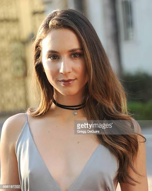 Actress Troian Bellisario arrives at the premiere of Lifetime's 'Sister Cities' at Paramount Theatre on August 31 2016 in Hollywood California