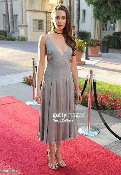 "Actress Troian Bellisario arrives at the premiere of Lifetime's ""Sister Cities"" at Paramount Theatre on August 31, 2016 in Hollywood, California."