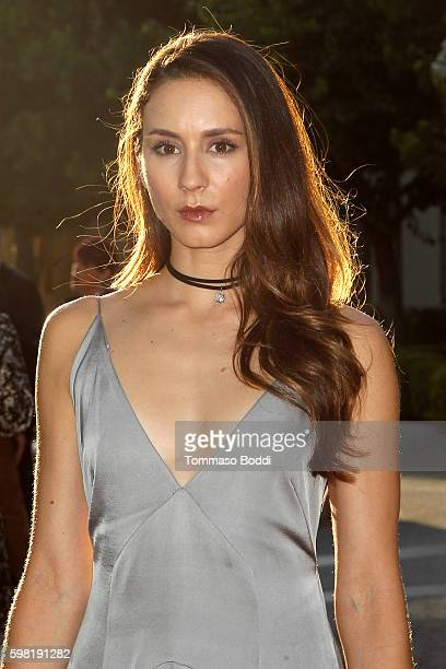 "Actress Troian Bellisario attends the premiere of Lifetime's ""Sister Cities"" held at Paramount Theatre on August 31, 2016 in Hollywood, California."